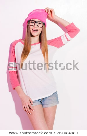 Playful girl looking at the camera against a white background Stock photo © wavebreak_media