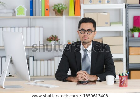 man daydreaming at his desk stock photo © photography33