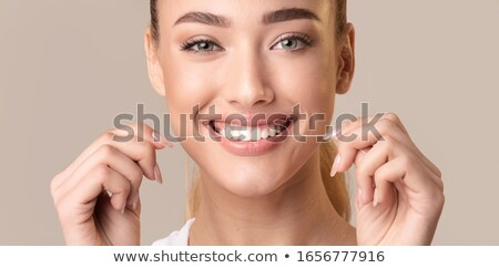Happy woman using dental floss Stock photo © wavebreak_media