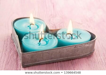 Lit pink candles in heart shape Stock photo © wavebreak_media