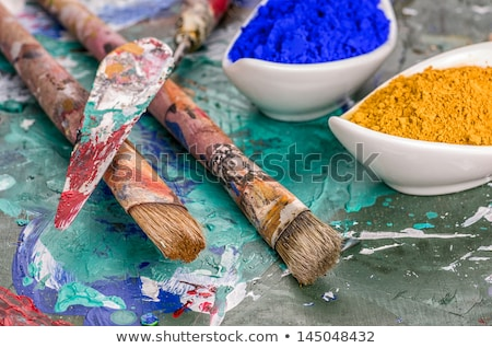 Brush, spatula and color pigments on a wooden palette Stock photo © Zerbor