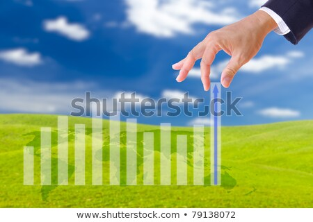 business man hand bring up the graph Stock photo © tungphoto