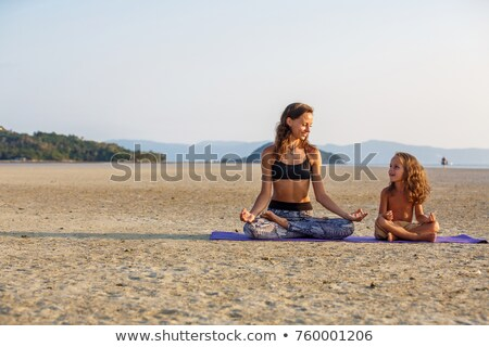 Mother and son doing yoga stock photo © HASLOO