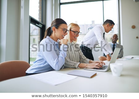 улыбаясь молодые деловая женщина Smart черное платье Постоянный Сток-фото © fantasticrabbit