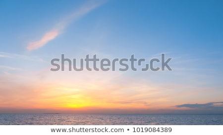Vurig zonsopgang hemel zomer zee landschap Stockfoto © BSANI