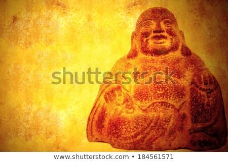 Sonriendo Buda sesión pergamino Foto stock © marimorena