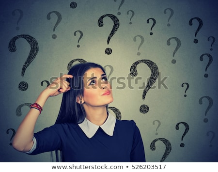 portrait of confused and uncertain hispanic woman stock photo © diego_cervo