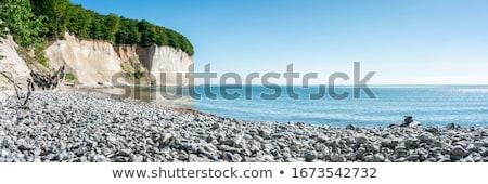 cascalho · praia · pôr · do · sol · cinco · parque - foto stock © fotoaloja