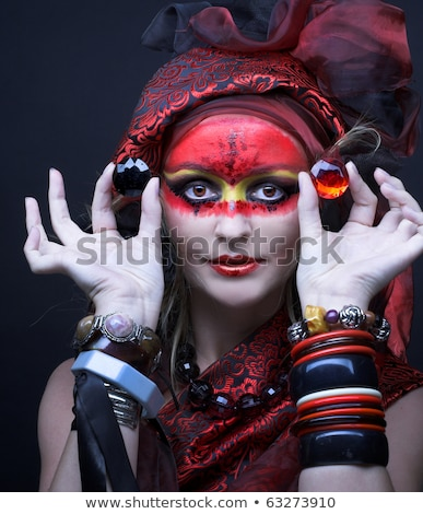 Portrait of a mysterious woman with artistic make-up on her fac Stock photo © Nejron