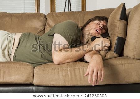 Pigro uomo dormire divano divano Foto d'archivio © ArenaCreative