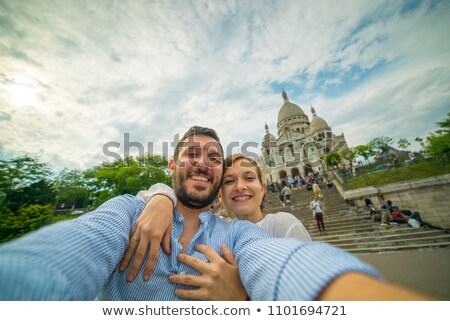 couple on a background of Basilica of the Sacre Coeur Stock photo © sarymsakov