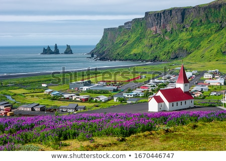 The church of Vik in Iceland Stock photo © elxeneize