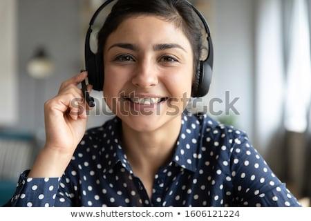 Closeup portrait of woman with headset stock photo © nyul