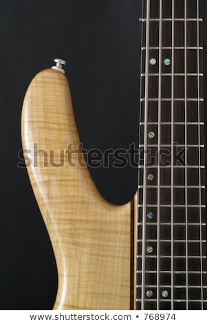 black bass guitar with strained strings stock photo © your_lucky_photo