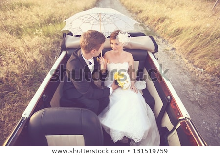 beautiful bride outdoors with white umbrella stock photo © artfotodima