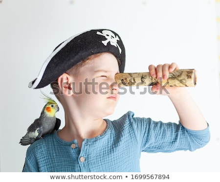 happy pirate with a parrot on his shoulder stock photo © studiostoks