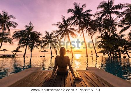 Lány tengerpart napfelkelte szőke nő áll gyönyörű Stock fotó © Kotenko