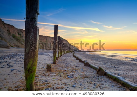 sheringham beach and cliffs at sunsetengland stock photo © capturelight