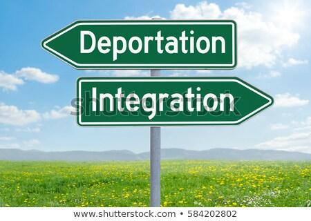 Stockfoto: Twee · groene · richting · borden · deportatie · integratie