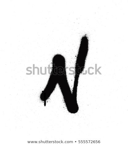 sprayed n font graffiti with leak in black over white stock photo © melvin07