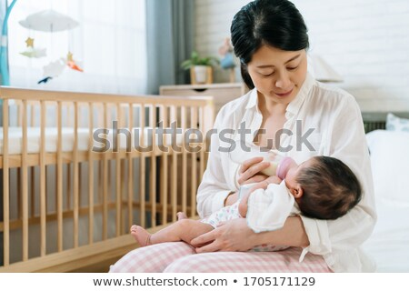 baby girl sitting in her crib  Stock photo © feedough