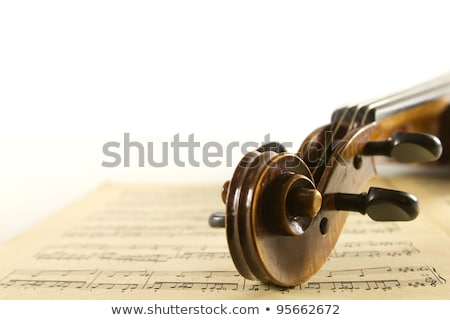 close up of brown violin with sheet music stock photo © wavebreak_media