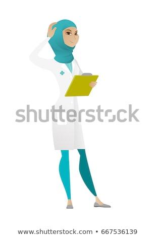 Young muslim doctor scratching her head. Stock photo © RAStudio