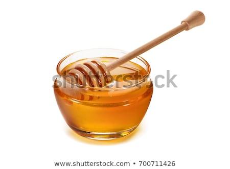 Cuchara de madera miel blanco fondo postre líquido Foto stock © orensila