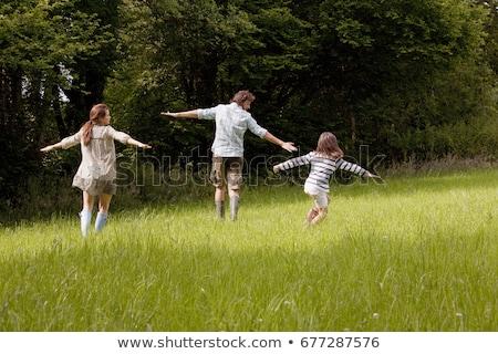 Férfi mező karok nyitva égbolt természet Stock fotó © IS2
