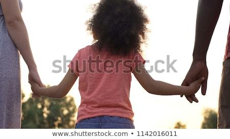 Boldog apa gyermek kéz a kézben család gyermekkor Stock fotó © dolgachov
