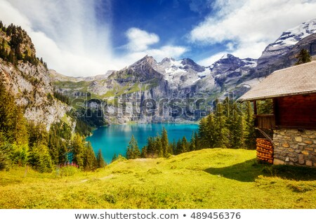 Great panorama of the azure pond Oeschinensee. Location Swiss al Stock photo © Leonidtit