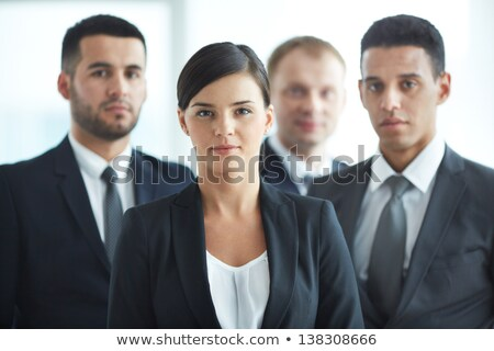 Four business people looking to camera Stock photo © IS2