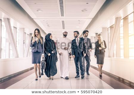 oriente · médio · empresário · mulher · caminhada · corredor · escritório - foto stock © monkey_business