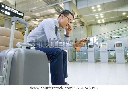 Businessman sitting in corridor Stock photo © IS2