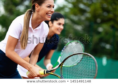 Couple with tennis rackets Stock photo © IS2