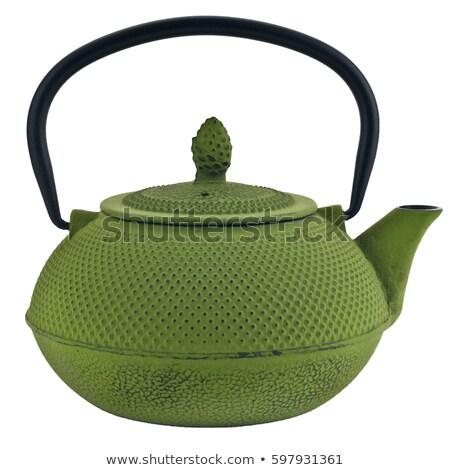 Black metal oriental teapot isolated Stock photo © dash
