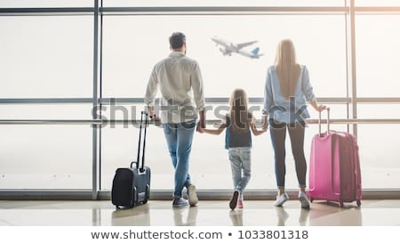 Happy family at the airport waiting for a flight Stock photo © Imaagio