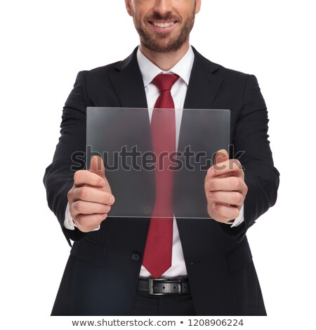 Stock photo: body of smiling businessman presenting futuristic tablet