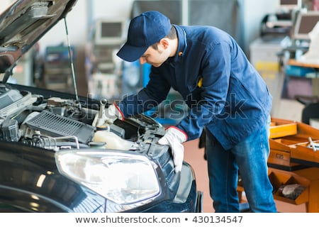 Autószerelő dolgozik autó garázs kék munkás Stock fotó © Minervastock