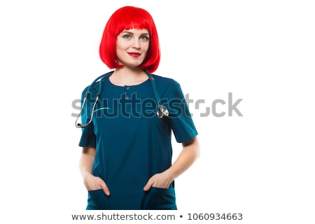 Attractive funny smilling caucasian brunette female doctor in red wig standing in office fooling Stock photo © Traimak