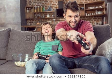 Baba oğul oynama video oyunu oturma odası bilgisayar aile Stok fotoğraf © Lopolo