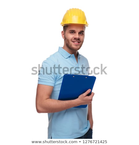 relaxed engineer wearing blue polo shirt holds pockets Stock photo © feedough