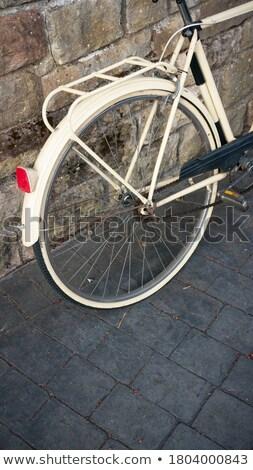 Retro beige bicycle parked outdoors in Europe Stock photo © artfotodima