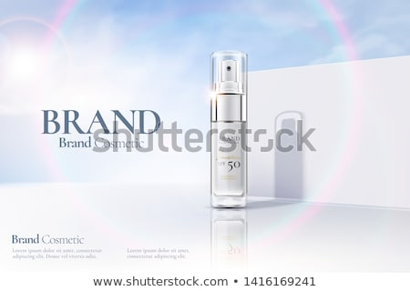 Cosmetic bottles on a blue sky background Stock photo © kjpargeter
