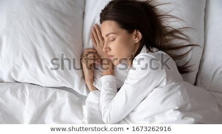 Uśmiechnięty młoda kobieta piżama bed młodych Zdjęcia stock © dashapetrenko