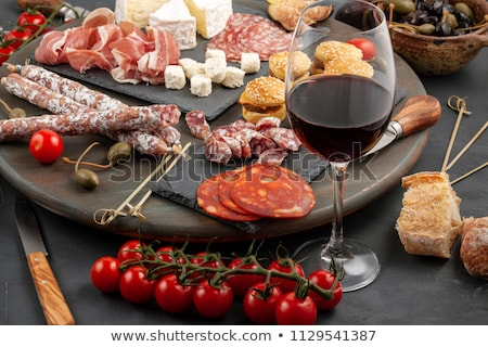 Appetizers table with different antipasti snacks Stock photo © boggy