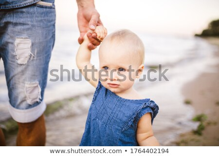 Father and his little daughter walking along the beach  Stock photo © dashapetrenko