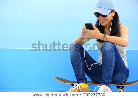 Sportok nő park kint hallgat zene Stock fotó © deandrobot