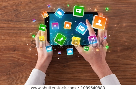 Stock photo: Hand using tablet with bounce application symbols concept