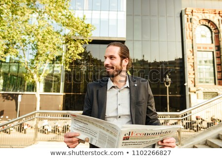 Portrait of european smart man 30s in formal clothing standing i Stock photo © deandrobot